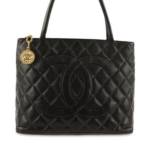 Chanel Classic Quilted Medalion Handbag!